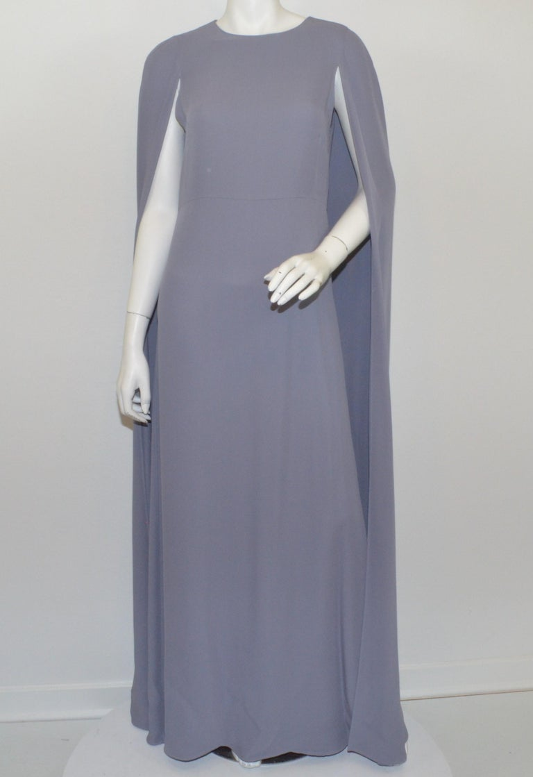 """Valentino Cape Gown as seen on Jennifer Lopez, Kim Kardashian, Katy Perry-- Featured in a lilac color with a cape design and column gown. Dress has a back zipper fastening. Labeled size 8, made in Italy.  Measurements: Bust 36"""" Waist 32"""" Hips"""