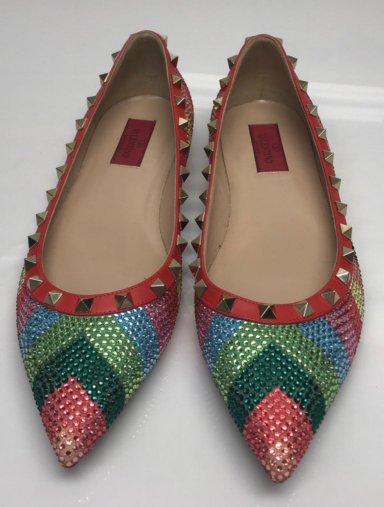 Valentino Multi color iridescent flats w/ studs-39. These amazing Valentino flats are in excellent condition. They show minimal signs of use. They have a multi colored chevron pattern with iridescent rhinestones throughout. There is a red leather
