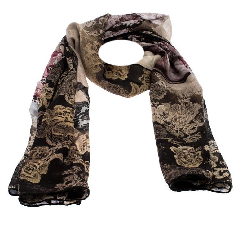 Accessorize your outfits with this multicoloured scarf fabricated in luscious silk. Valentino has designed this scarf with a beautiful floral lace print. It is finished with rolled hems and makes for a stylish addition to your closet.  Includes: The