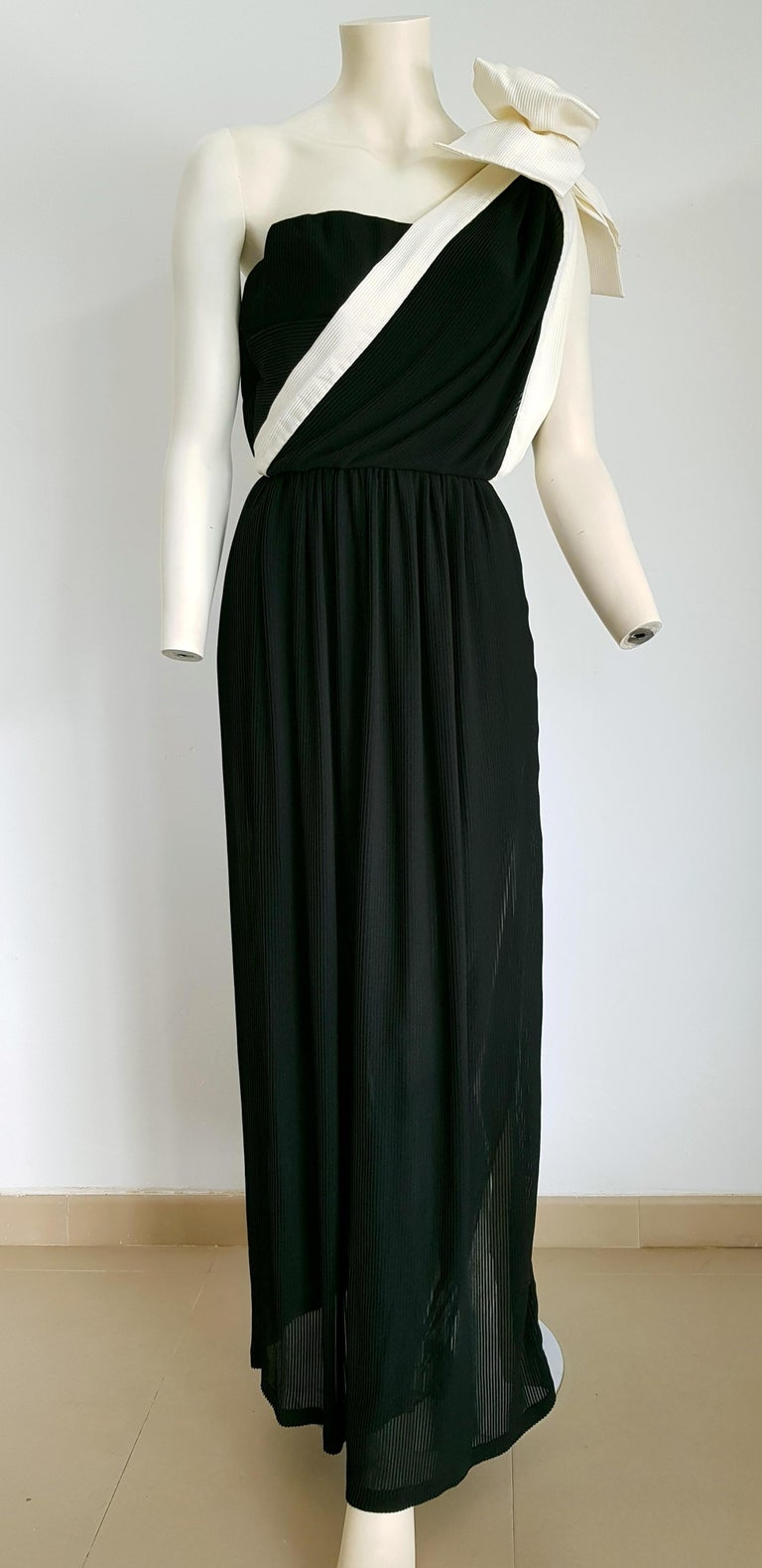 VALENTINO Haute Couture, one shoulder strap with white bow, vertical white left side stripe, pleated black silk dress gown - Unworn, New.  By