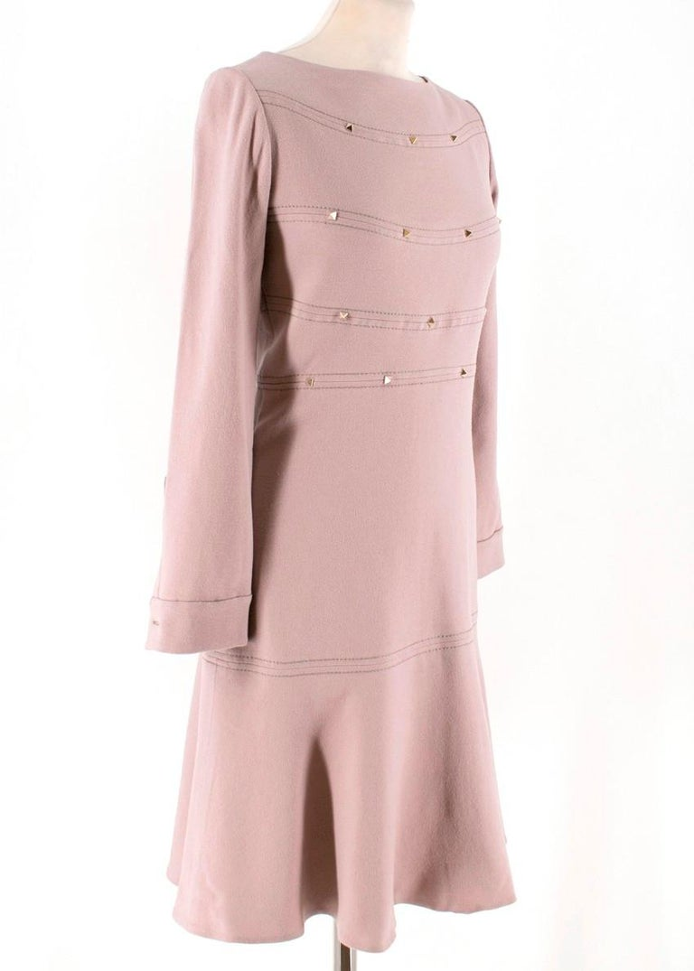 Valentino Nude Pink Rockstud Long-Sleeved A-Line Dress.  - 98% Fleece wool / 2%Elastane - Nude pink colour with decorative signature Rockstud's on the chest & back - High neck - Paneling & tonal top stitching  - Long sleeved - pleated cuff button