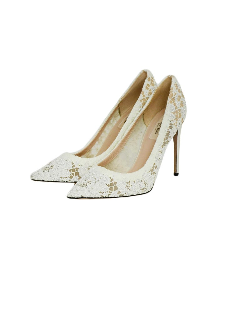 Valentino off-White Lace/Crystal Point Toe Pumps sz 39  Made In: Italy Color: off-white Materials: Lace, leather Closure/Opening: Slide on Overall Condition: Excellent pre-owned condition, very minor wear on soles. Estimated Retail: $1,695 +