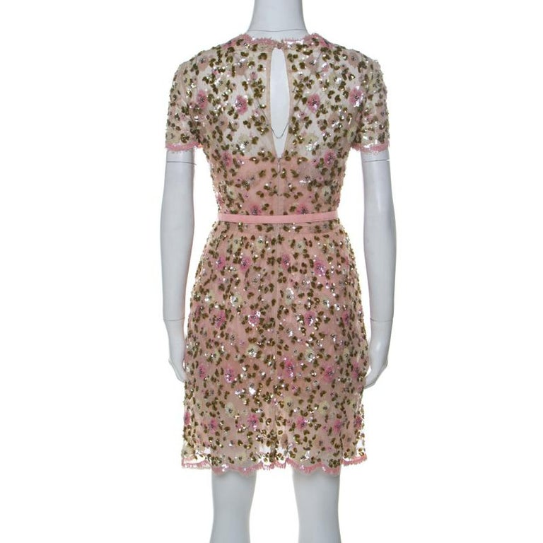 This Valentino dress cannot be more perfect as it is overflowing with exquisiteness. From its silhouette to its immaculate craftsmanship, the dress looks ready to give you a magical experience. Made from quality fabrics like silk and nylon, it comes