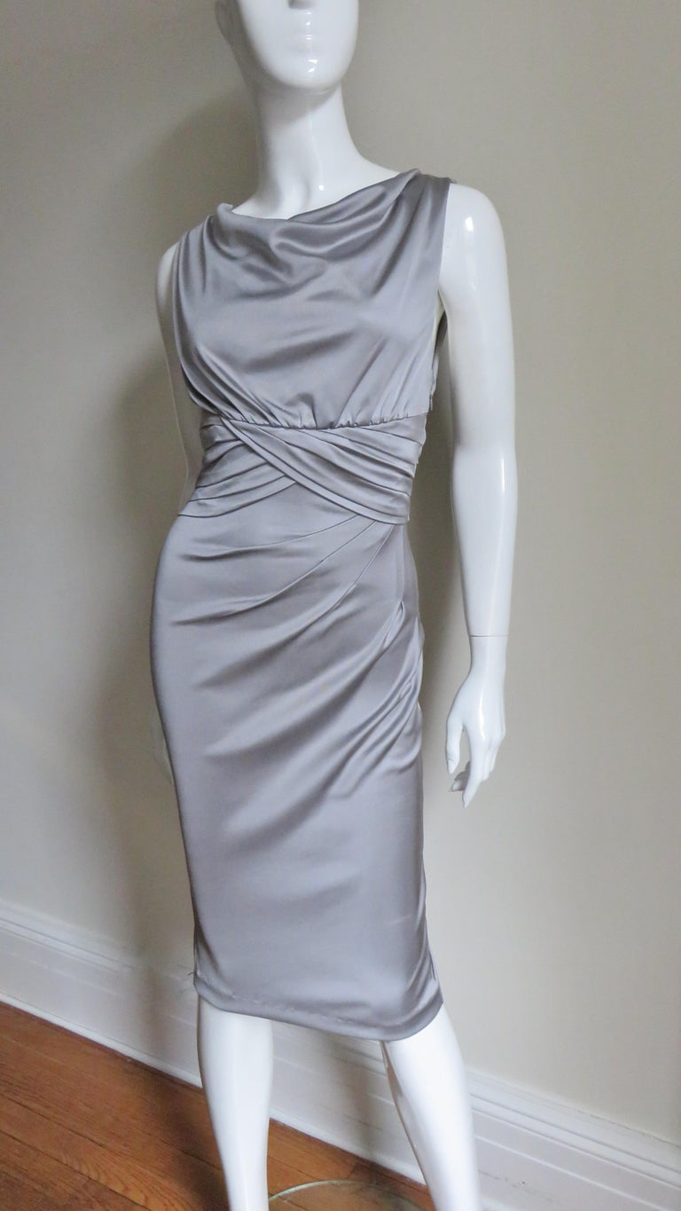 A beautiful platinum grey silk jersey dress from Valentino.  It is sleeveless with a subtly draped neckline, ruched waist and angled ruching across the front of the skirt.  All of this detail creates a very flattering fit.  The bodice is lined in