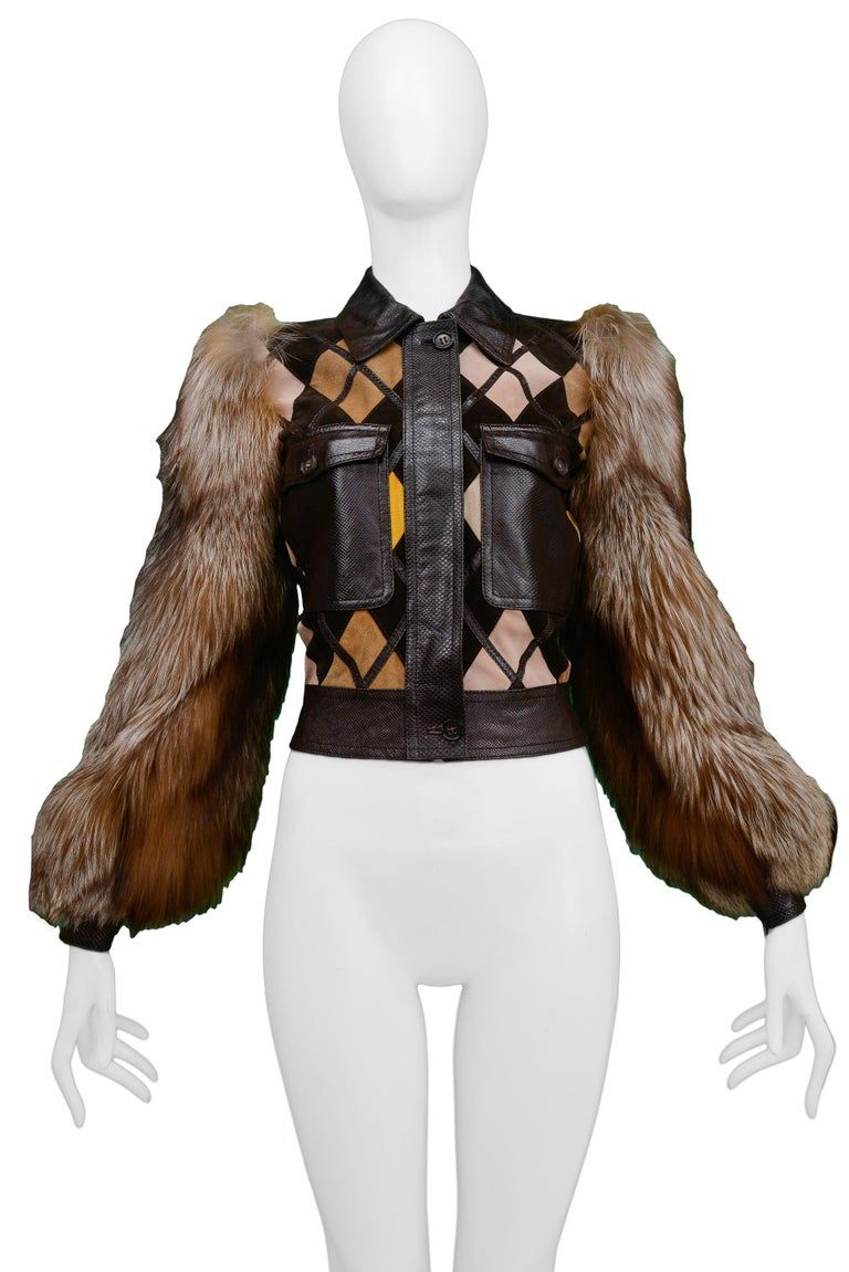 Resurrection Vintage is excited to offer a rare vintage Valentino leather and fur jacket featuring dark brown python texture panels and trim, multicolor diamond leather panels, a folding collar, button front pockets, button placket, full fur