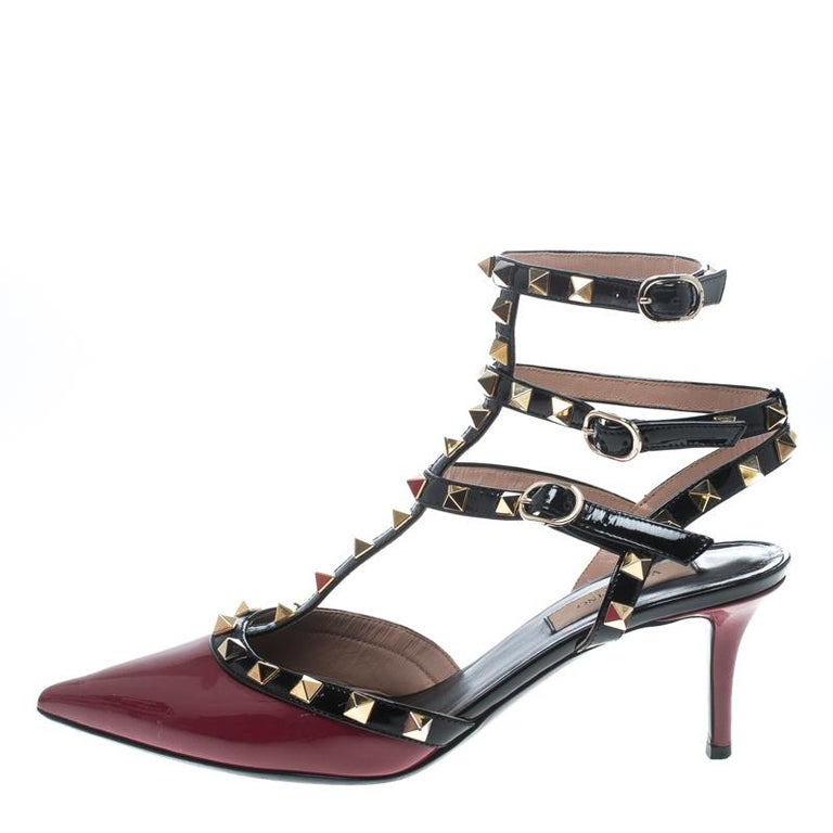 Stylish and very chic, these Rolling Rockstud sandals from Valentino will fetch you admiring glances for every step you take! The red and plack sandals are crafted from patent leather and feature pointed toes, a T-strap design with multiple