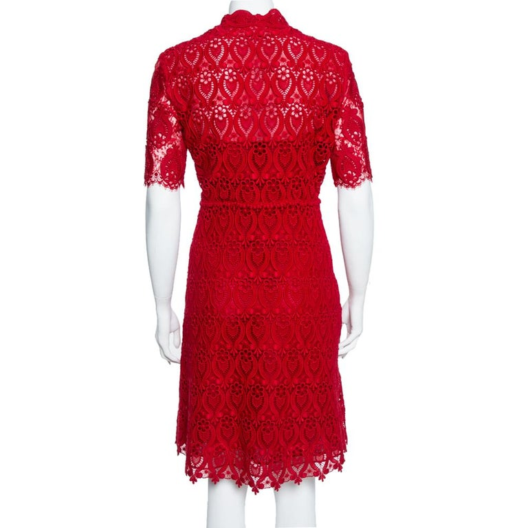 Exhibiting a beautiful floral lace design, this sheath dress from Valentino is one of a kind! The red creation features a flattering silhouette and is styled with front button fastenings and short sleeves. It will look great with strappy stilettoes