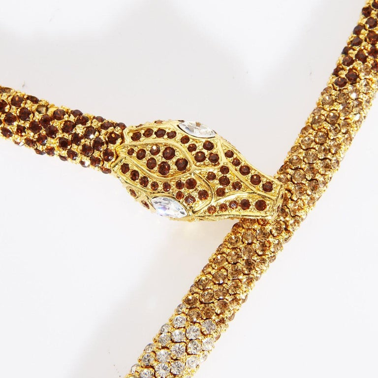 A stunning example of finely crafted costume jewelry from the historically significant 20th century Italian Haute Couture designer Valentino Garavani. The coiled nature of the 24 karat  gold plated links with the painstakingly placed pavé Austrian