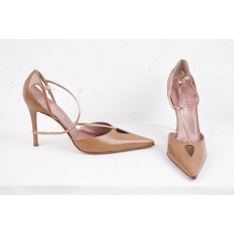 MATERIAL: Leather COLOR: Tan MODEL: Pumps GENDER: Women SIZE: 38 COUNTRY OF MANUFACTURE: Italy Condition CONDITION DETAILS: B :GOOD CONDITION - Some light wear of use- Minimal scratches on leather, some normal wear of use on the outsoles - Internal