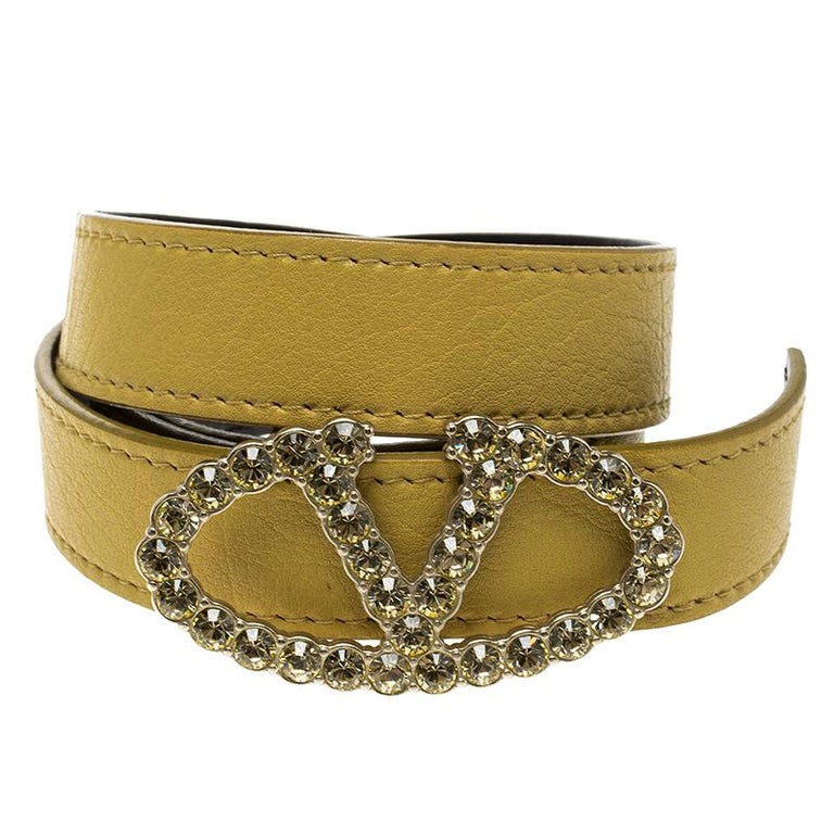 Valentino is one of the most leading fashion houses in the world. Made in Italy, this leather belt is a signature Valentino design as it is made from patent leather. The buckle is the