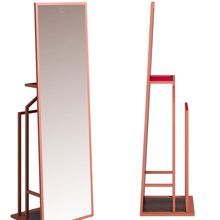 A modern take on an iconic piece of furniture, this valet mirror showcases masterful craftsmanship and quality of materials in a simple yet elegant piece that will add functionality to a modern bedroom or entryway, thanks to its full-length mirror.