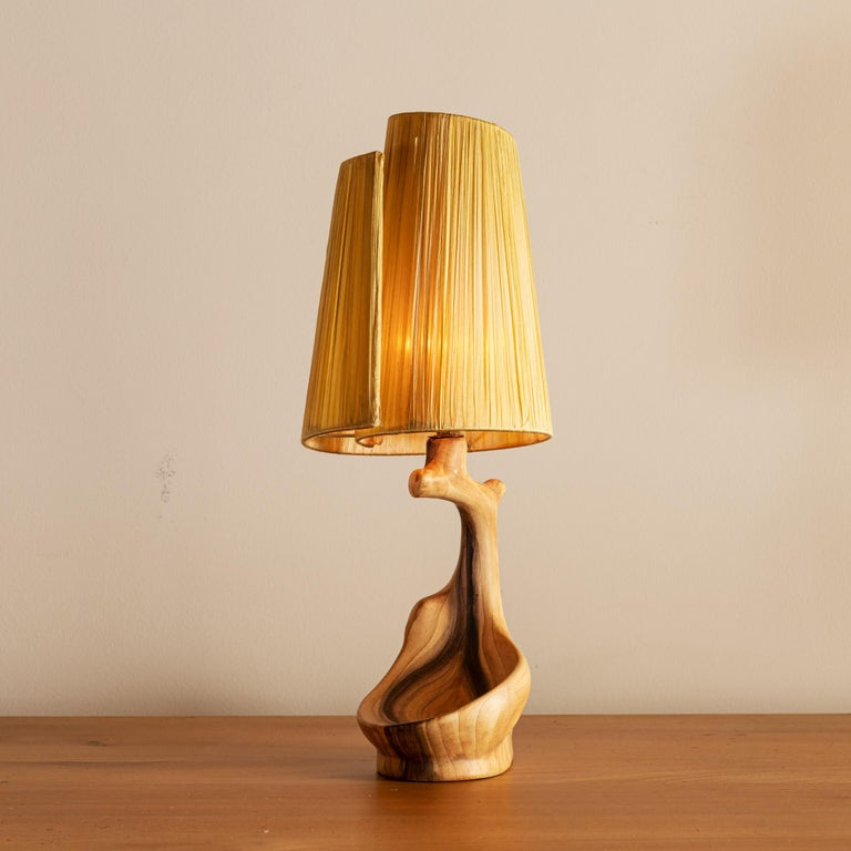 Organic and charming Vallauris table lamp in faux bois glaze with spiral shade, inscribed on underside, France, 1950s.