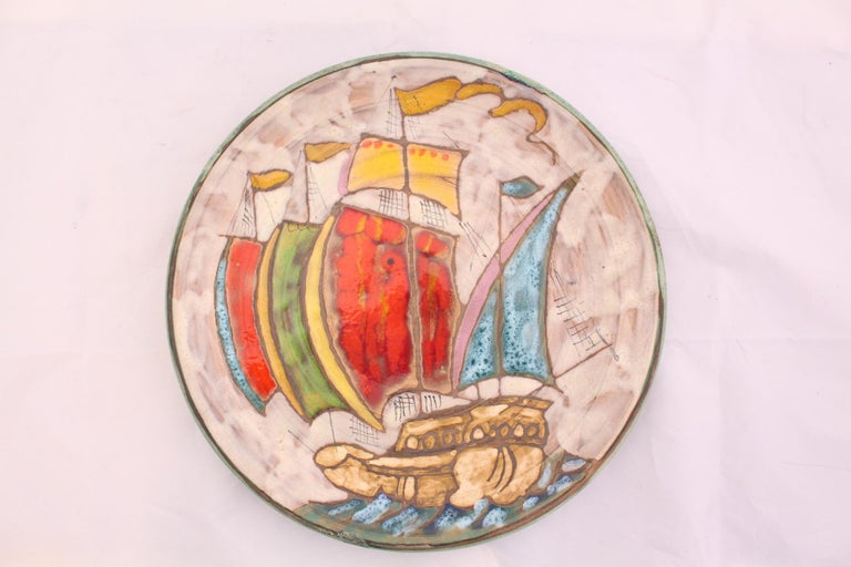 Midcentury plate unique Vallauris hand painted Stylised Galleon at Sea  Stylish and decorative great addition to Provençal collection of Art Studio Pottery  Good condition with two small old restorations to the edge please see photos.