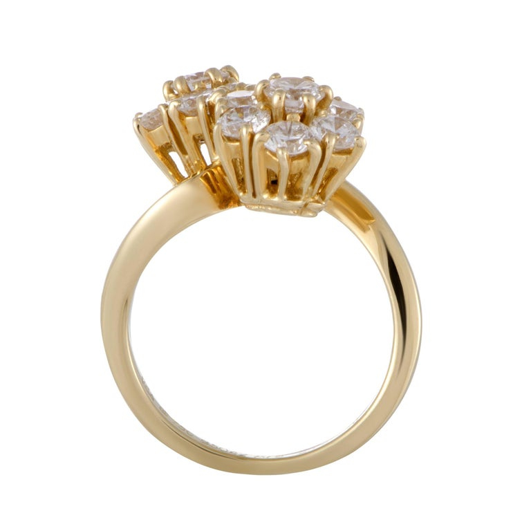 An epitome of graceful elegance, this gorgeously feminine ring is designed by Van Cleef & Arpels and presented in radiant 18K yellow gold. The ring is splendidly decorated with colorless (grade F) diamonds of VVS clarity that weigh 1.70 carats in