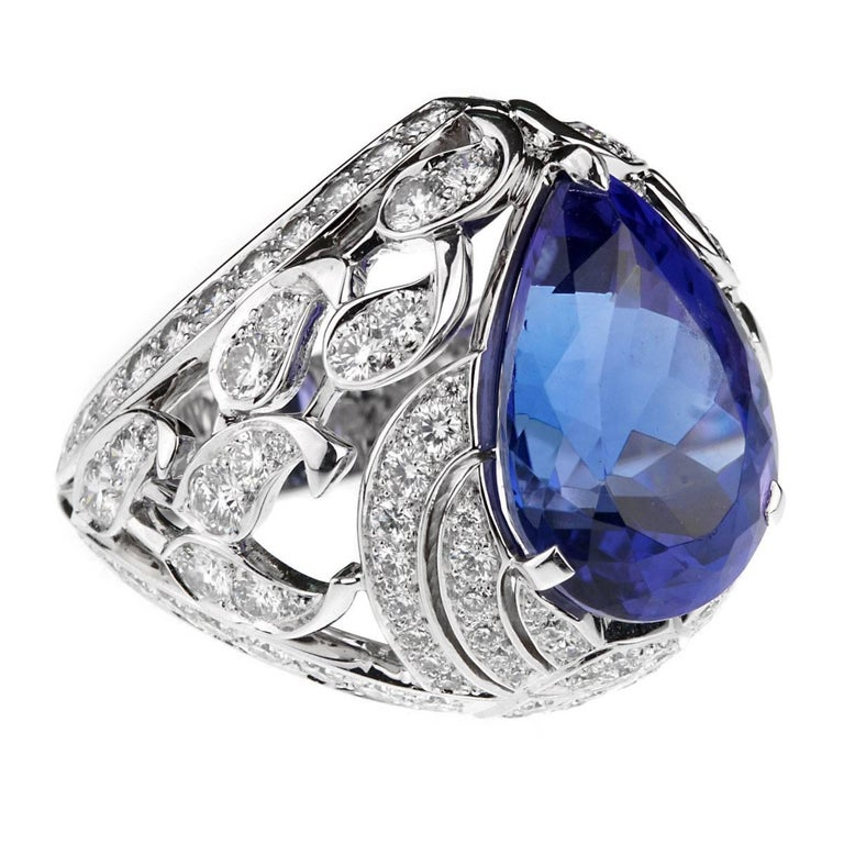 A magnificent one of a kind creation by Van Cleef & Arpels from the Les Jardins collection featuring a striking pear shaped Tanzanite stone adorned by the finest round brilliant cut diamonds in a floral motif set in 18k white gold. The ring is