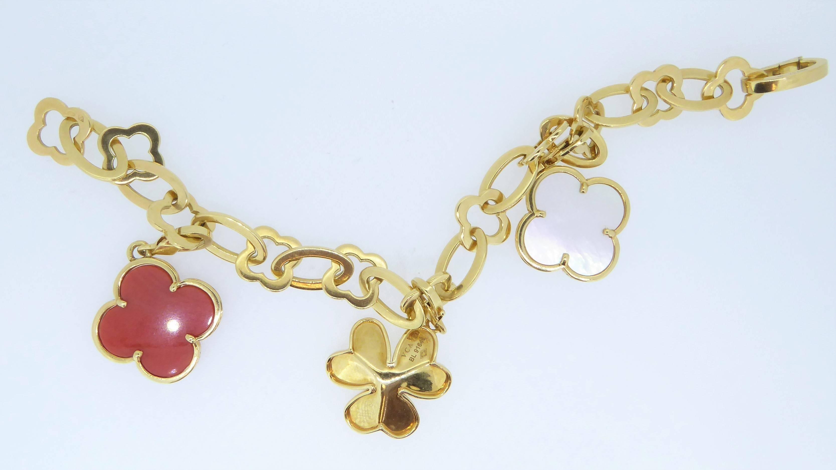 Van Cleef And Arpels 18 Carat Yellow Gold Diamond C Mop Charm Bracelet At 1stdibs