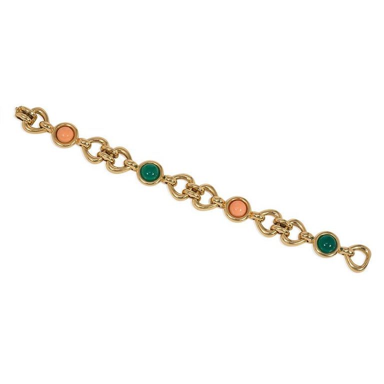 An estate gold, coral, and chrysoprase bracelet featuring stylized, opposing heart-shaped links with alternating cabochon coral and chrysoprase, in 18k. Van Cleef & Arpels, France. #122325, with maker's mark for Péry et Fils.