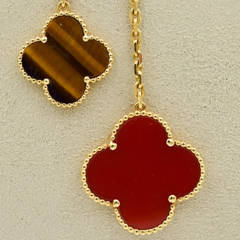 This beautiful Van Cleef & Arpels necklace was recently traded in to our store and is in very good condition.  This Alhambra necklace features alternating Carnelian and Tigers Eye Motifs.  The chain is in 18k yellow gold and 16