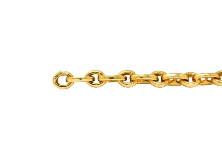 Modernist Van Cleef & Arpels Coral Black Onyx 18 Karat Gold Articulated Fish Bracelet For Sale