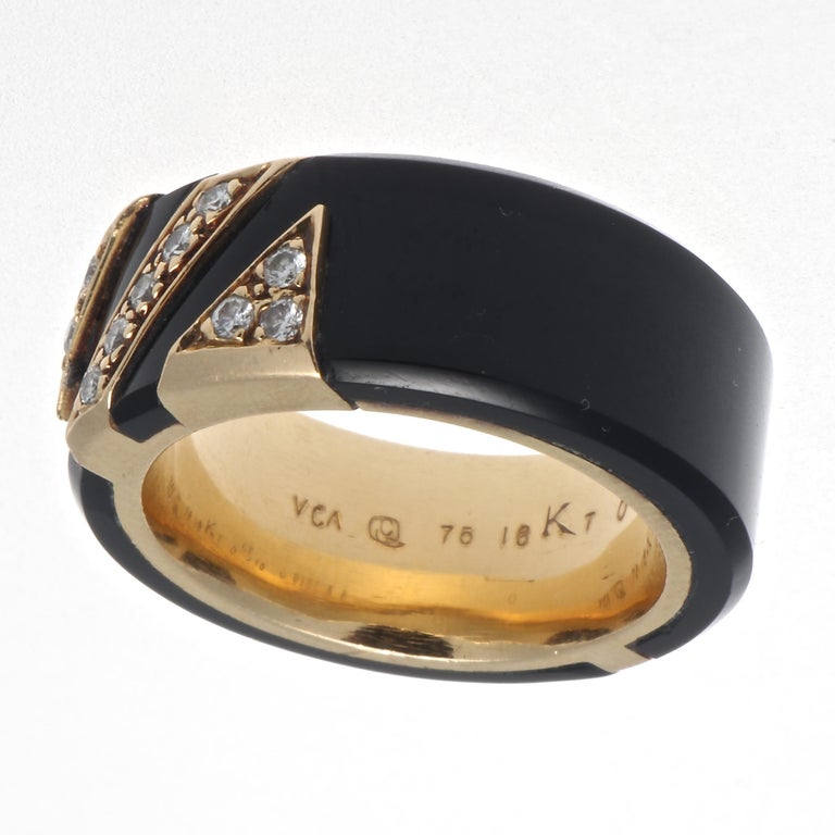 Van Cleef & Arpels France diamond onyx 18k yellow gold ring. Featuring 11 round brilliant diamonds that are E-F color, VVS+ clarity. Signed VCA serial #C5157X8. Stamped with French hallmarks. Circa 1975. Ring size 5-1/4. Diamond weight and year
