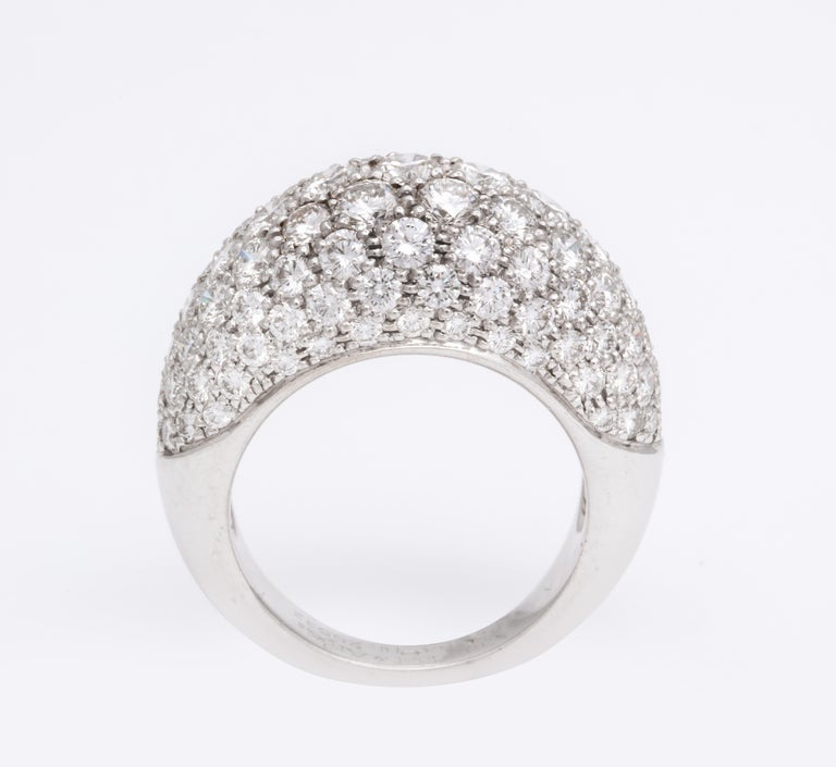 A sexy pave diamond ring (ladies size 7) features approximately 5 carats of very fine quality round brilliant diamonds expertly set in this classic french silhouette, signed Van Cleef & Arpels