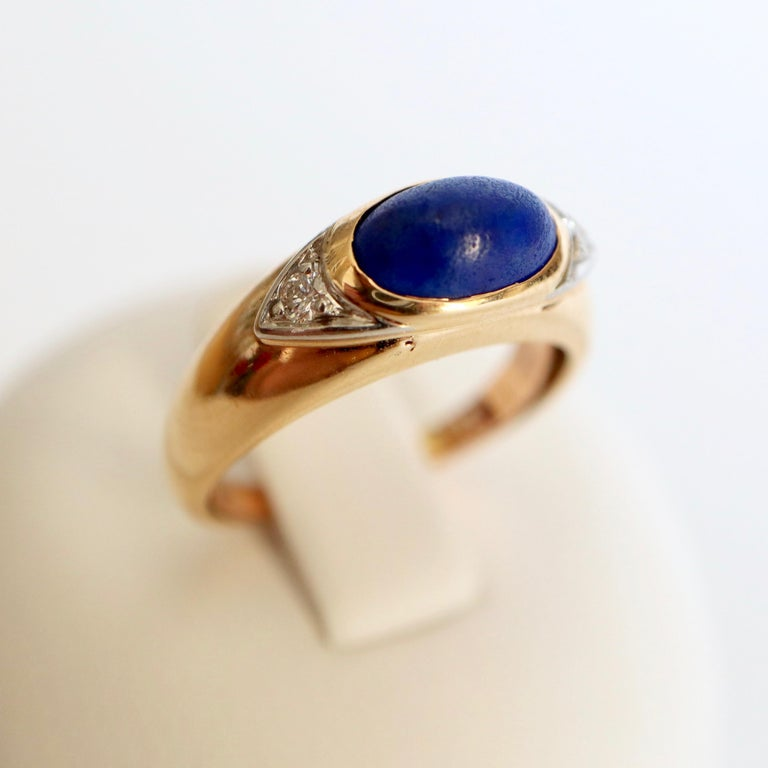 VAN CLEEF and ARPELS ring yellow Gold and white Gold 18 Carats retaining Lapis Lazuli Cabochon with a Diamond set on both Sides set in white Gold. VCA Spring ring inside. Signed VCA and numbered  Diameter 16.5 Size 52 Gross weight: 4.4 g