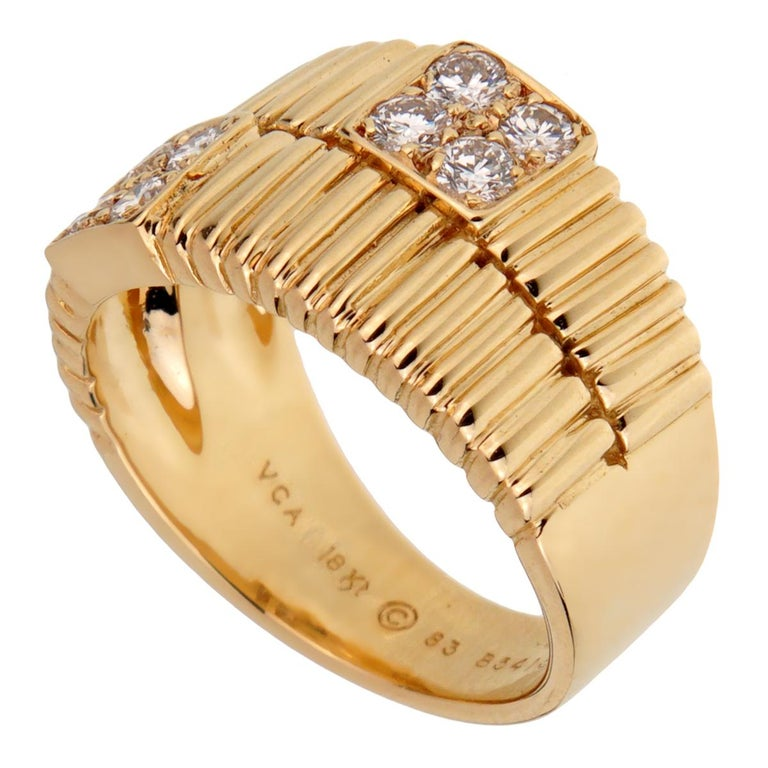 A chic Van Cleef & Arpels vintage diamond ring circa 1990s showcasing a ribbed pattern set with 8 round brilliant cut diamonds in 18k yellow gold.  Size 5 1/2