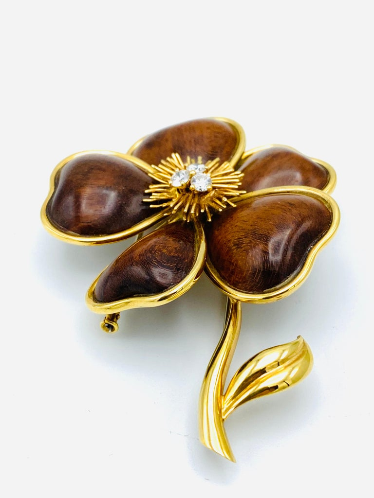 Product details: Created by Van Cleef and Arpels in France in 1972's.  It is made of 18K yellow gold, amourette wood and accented with three round brilliant cut diamonds, total weight is 0.45 carat. Stamped with VCA maker's mark, hallmark for 18K