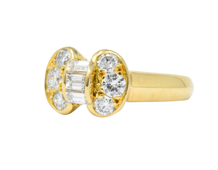 Designed as a unique bow set with approximately 0.60 CTW of round and emerald cut diamonds  Diamonds are F-G color and VS clarity   Tested as 18 karat yellow gold  Signed VCA for Van Cleef and Arpels, 750 with serial number   Circa 1980   CTW: