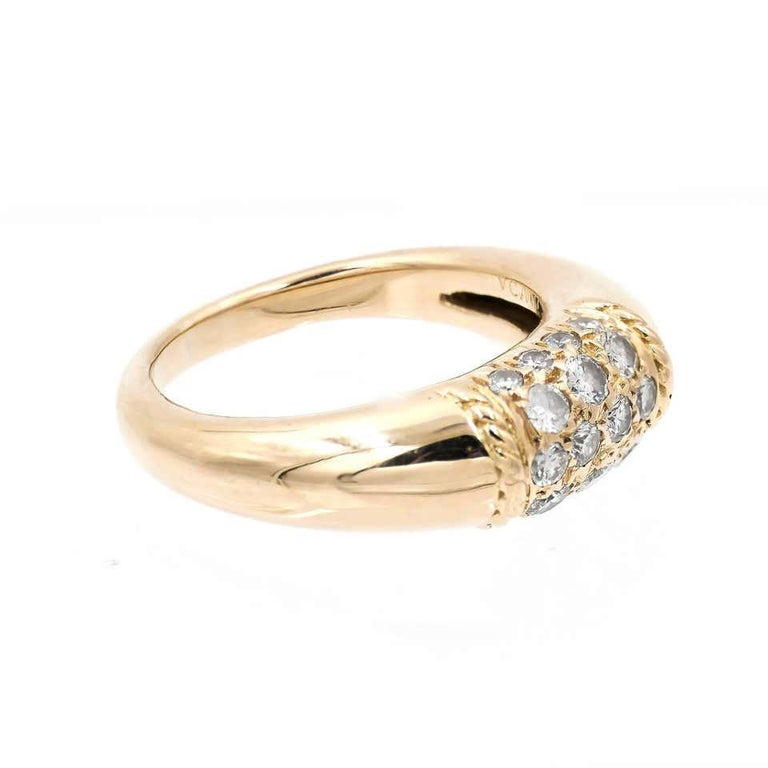 """VAN CLEEF & ARPELS, """"Philippine"""" ring in 18K yellow gold, 750/000ths The center adorned with a paving of round brilliant-cut diamonds between two twisted patterns.  Total diamonds weight : 0.20 cts  F – G, VVS2 – VS1  Finger size : 52 (US size :"""