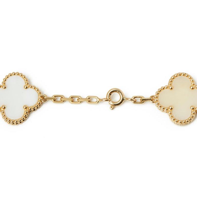 Van Cleef & Arpels 18 Karat Yellow Gold White Coral Vintage Alhambra Necklace For Sale 2