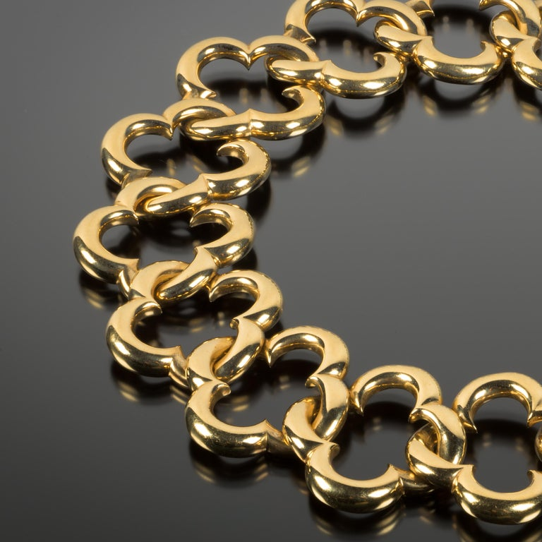 Rare in scale, this vintage Van Cleef & Arpels 18k gold open link Alhambra necklace is the ultimate statement piece. Consisting of 16 large interlocking quatrefoil links measuring approximately one inch long, the necklace captures the essence of the