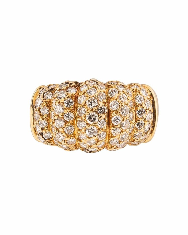 This 18K Gold and Diamond ring is set with approximately 0.90 carats of full cut diamonds. Size 6.25. Numbered, makers mark and export stamp, signed.
