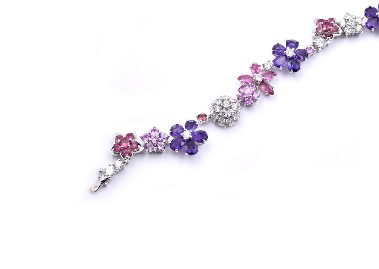 Designer: Van Cleef & Arpels Material: 18k white gold Sapphires: 72 mauve and pink sapphires = 15.26cttw Diamonds: 73 round brilliant cuts = 4.5cttw Color: G Clarity: VS Dimensions: bracelet measures 7.2-inches in length Weight: 21.53 grams