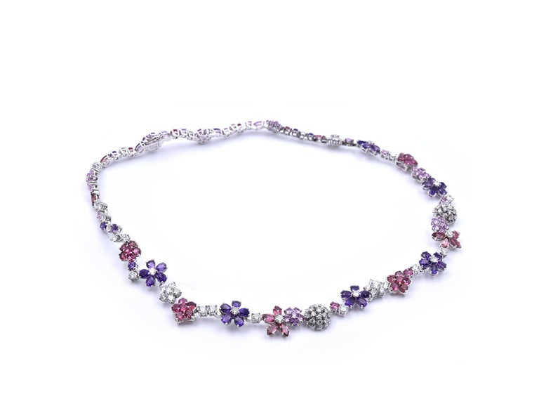 Designer: Van Cleef & Arpels Material: 18k white gold Sapphires: 127 mauve and pink sapphires = 23.64cttw Diamonds: 103 round brilliant cuts = 6.9cttw Color: G Clarity: VS Dimensions: necklace measures 14.5-inches in length Weight: 26.94 grams