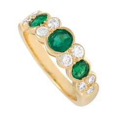 Van Cleef & Arpels 18K Yellow Gold 0.25 Ct Diamond and 0.75 Ct Emerald Ring