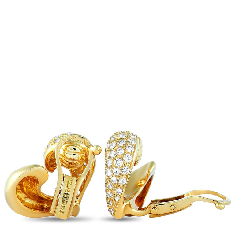 "These Van Cleef & Arpels earrings are made of 18K yellow gold and each of the two weighs 7.65 grams. They measure 0.62"" in length and 0.62"" in width. The pair is embellished with diamonds that boast F color and VVS clarity and amount to"