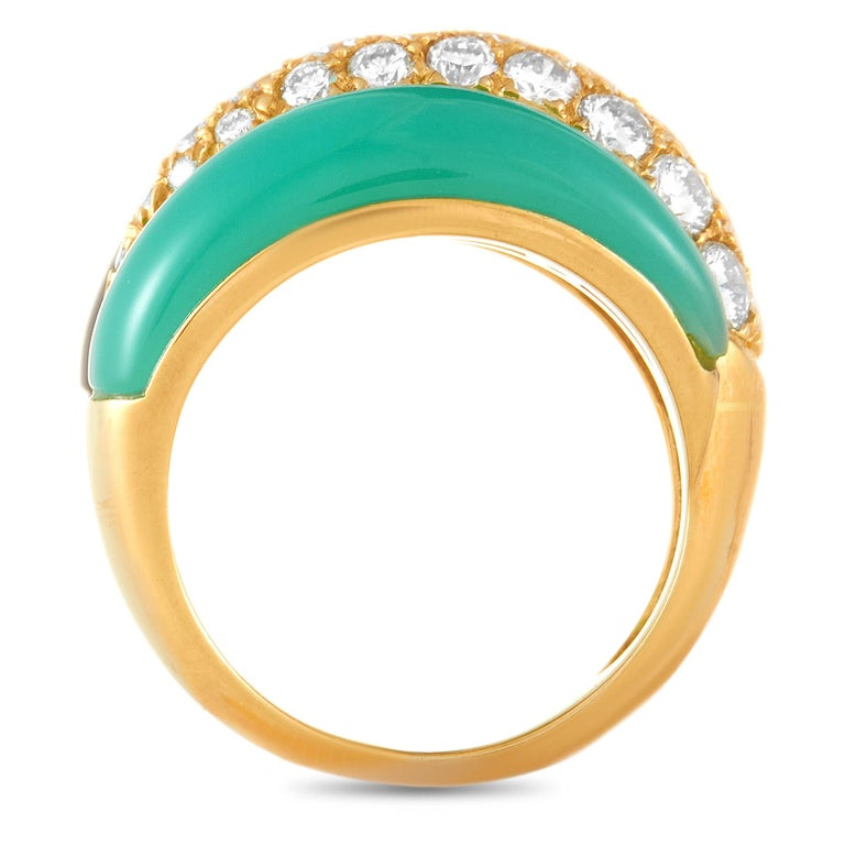 This Van Cleef & Arpels ring is crafted from 18K yellow gold and weighs 9.6 grams. It boasts band thickness of 5 mm and top height of 7 mm, while top dimensions measure 16 by 21 mm. The ring is set with chrysoprase, onyx, and a total of 1.51 carats