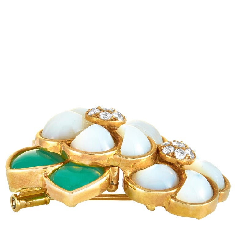 """This Van Cleef & Arpels brooch is crafted from 18K yellow gold and decorated with chrysoprase, mother of pearl, and a total of 0.45 carats of diamond stones that boast grade F color and VVS clarity. The pendant weighs 18.3 grams and measures 1.50"""""""