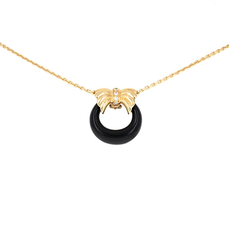 18k Yellow Gold Diamond Interchangable Pendant Necklace by Van Cleef & Arpels . This necklace comes with 3 interchangeable pendants. The pendants are Chalcedony, Black Onyx and Jade. The pendant closure has 5 round brilliant diamonds weighing an
