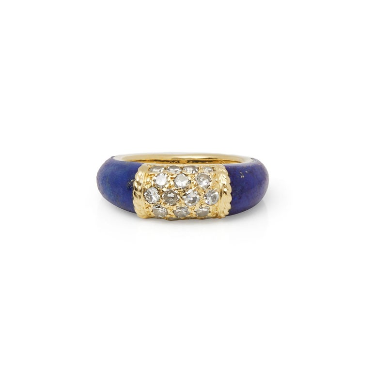 This Vintage Ring by Van Cleef and Arpels is from their Philippine Collection and features a Lapis Lazuli Carved Band with 18k Yellow Gold Pave Diamond section set with 18 Round Brilliant Cut Diamonds Totalling 0.90cts to the top. Ring Size UK O