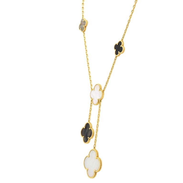 Magic Alhambra necklace by Van Cleef & Arpels. Multi-size mixed drops. Black onyx with white and gray mother-of-pearl. Created in 2006 by Van Cleef & Arpels, the Magic Alhambra jewelry creations gather different-sized Alhambra motifs, coming