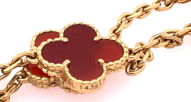 Van Cleef & Arpels 18 Karat Yellow Gold Carnelian 10 Motif Necklace In Good Condition For Sale In Stamford, CT