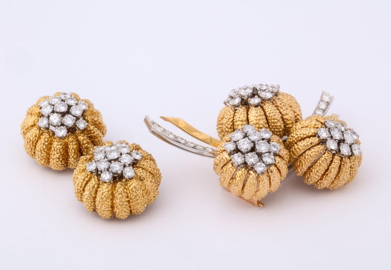 Made in France for the Van Cleef & Arpels New York boutique, this set exhibits the best of the signature 1960's attributes.  The beautifully textured yellow gold contrasts perfectly with the bright, white diamonds set in platinum and the volume is