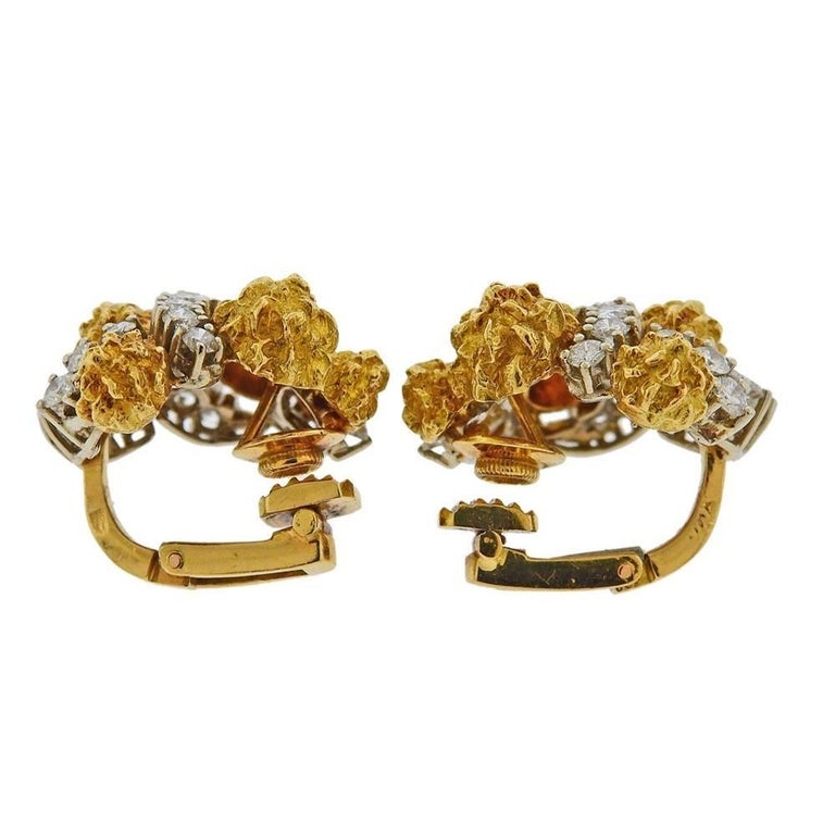 Pair of 1960s 18k gold earrings  by Van Cleef & Arpels, set with approx. 3.40ctw in diamonds. Earrings measure 25mm x 23mm. Marked VCA (one the back of one earring) Hallmark. Weight - 24 grams.E-01846