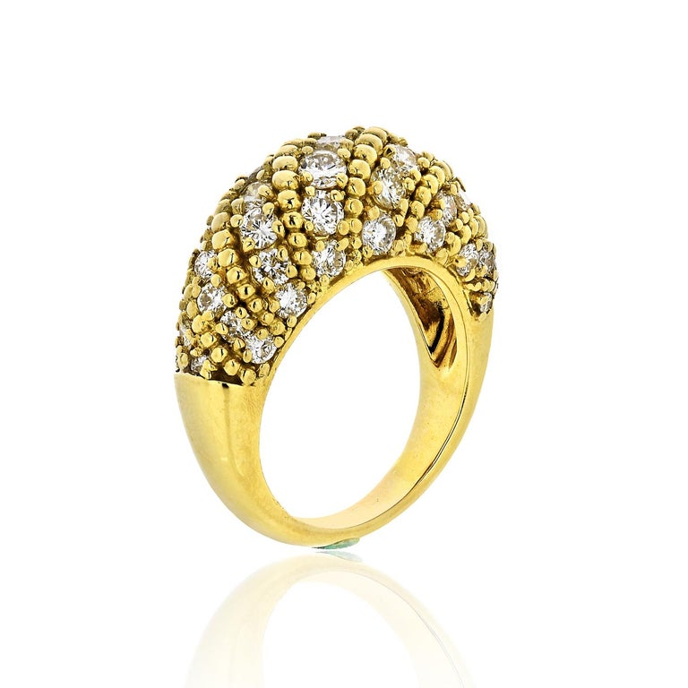This vintage ring dates from the 1970s and was designed by iconic jewelers Van Cleef & Arpels. Crafted from 18-karat gold, it is encrusted with 2.50-carats of round-cut diamonds.