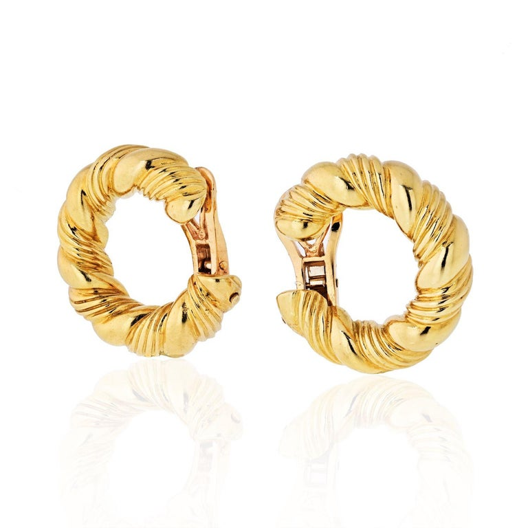 These earrings will be sure to make you feel glamorous, like Sofia Loren, vacationing on the Amalfi Coast. Very elegant twisted hoop earrings in 18k yellow gold, signed Van Cleef & Arpels. Circa 1970. Fashionable and with braided style, these