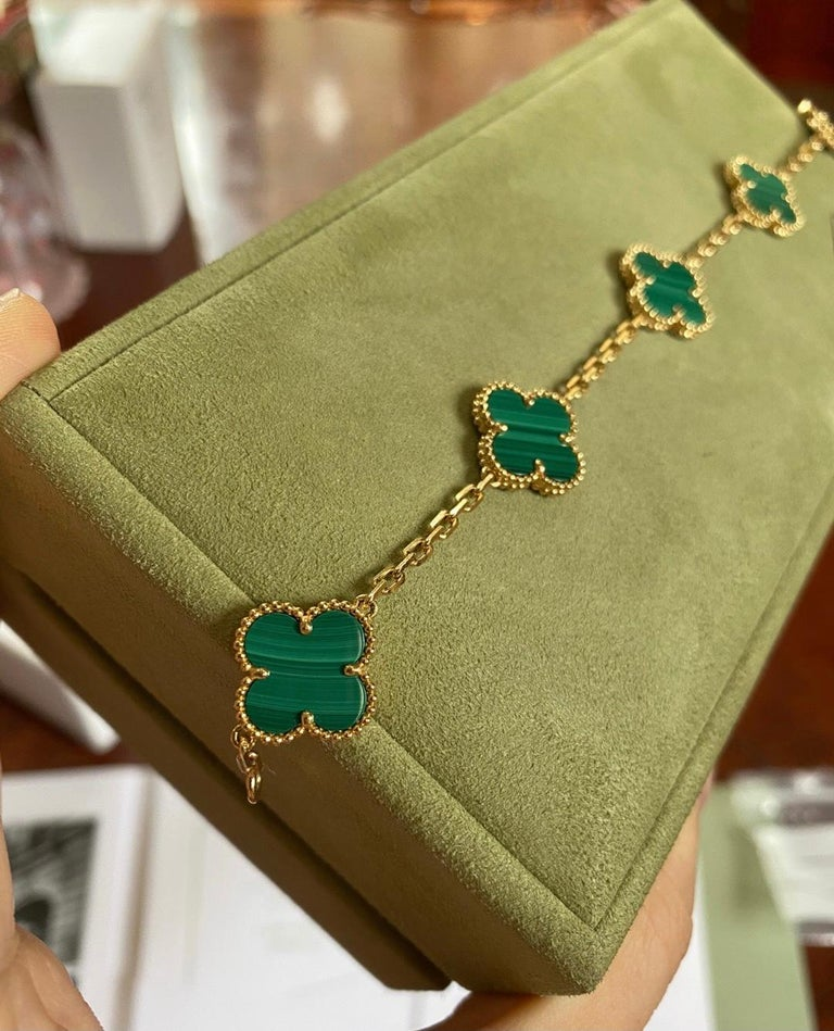 18k Yellow Gold 5-Motif Malachite Vintage Alhambra Bracelet by Van Cleef & Arpels.  The pendant comes with a VCA original box.  Retail Price: £3850  Every piece we sell is 100% authentic guaranteed, in very good condition. Every designer piece is