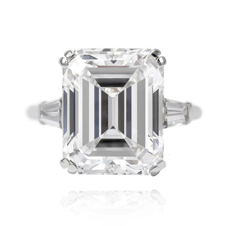 This beautiful signed piece from the Van Cleef & Arpels collection features a 8.94 carat Emerald Cut of E color and VVS2 clarity. Set in a platinum mounting with tapered baguettes, this classic ring will delight for a lifetime!   Purchase includes
