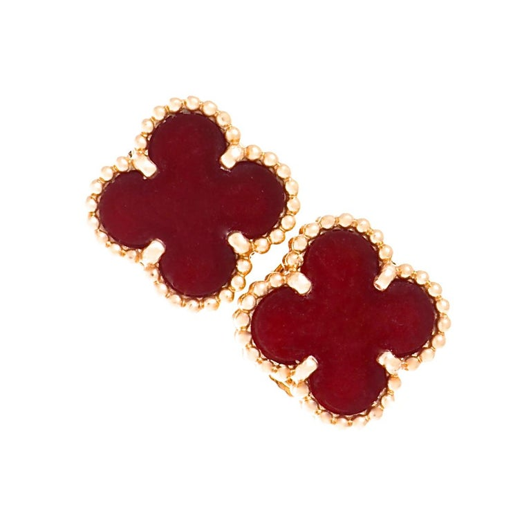 The iconic Alhambra motif from Van Cleef & Arpels, in rich carnelian, set in 18k rose gold. A true symbol of luck and good fortune, expressing continuity and legacy. Since its inception in 1960's Paris, the Alhambra line has captured the hearts of